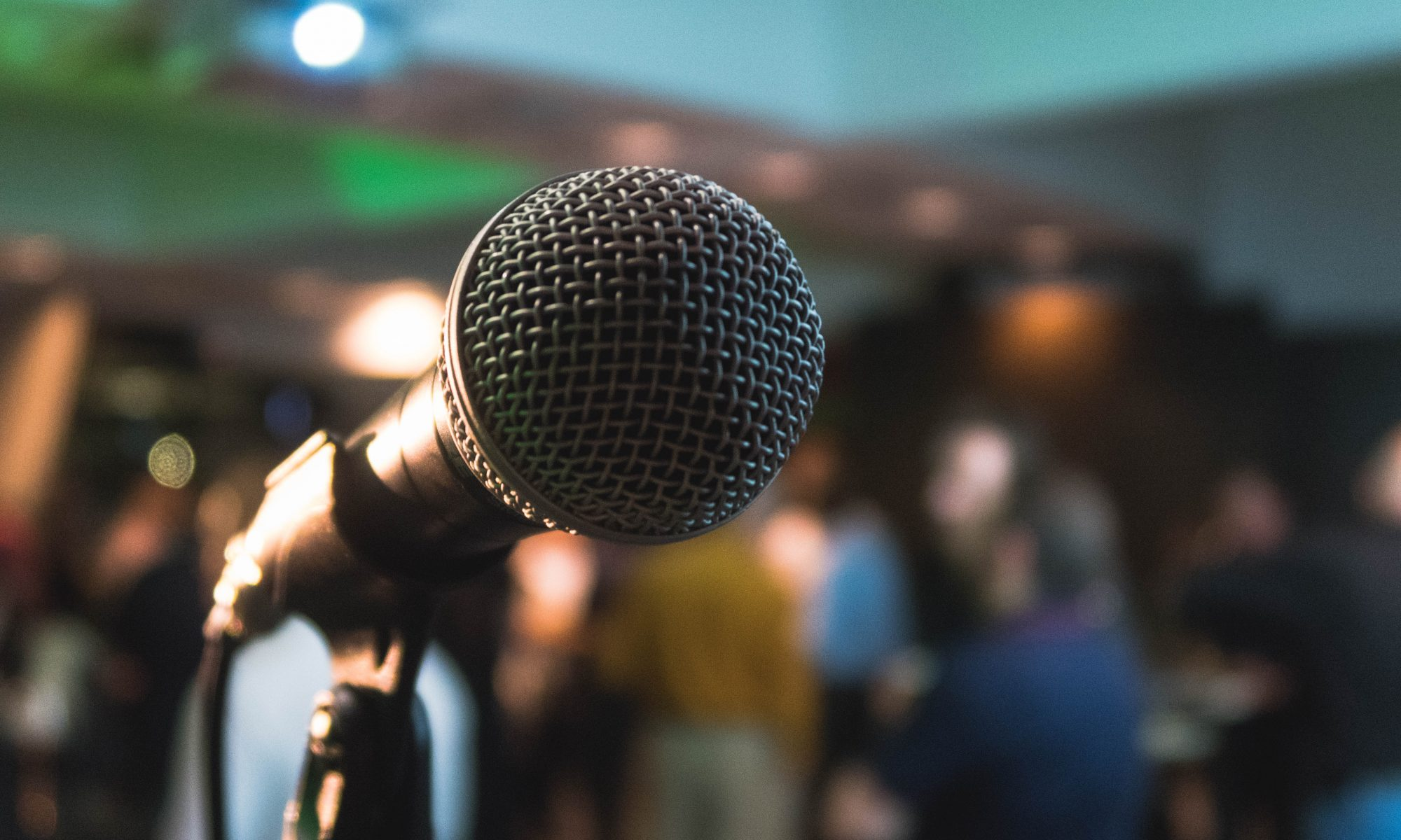 close up microphone in front of an audience