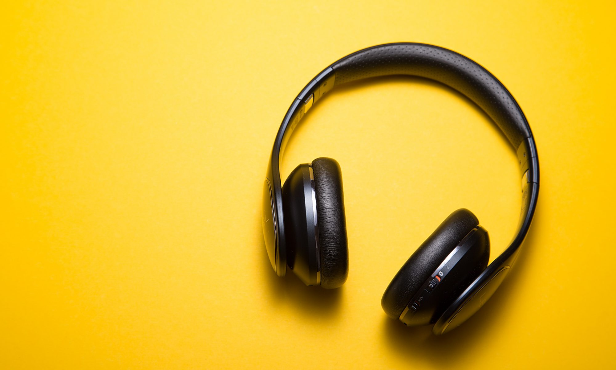 Headphones on a yellow background