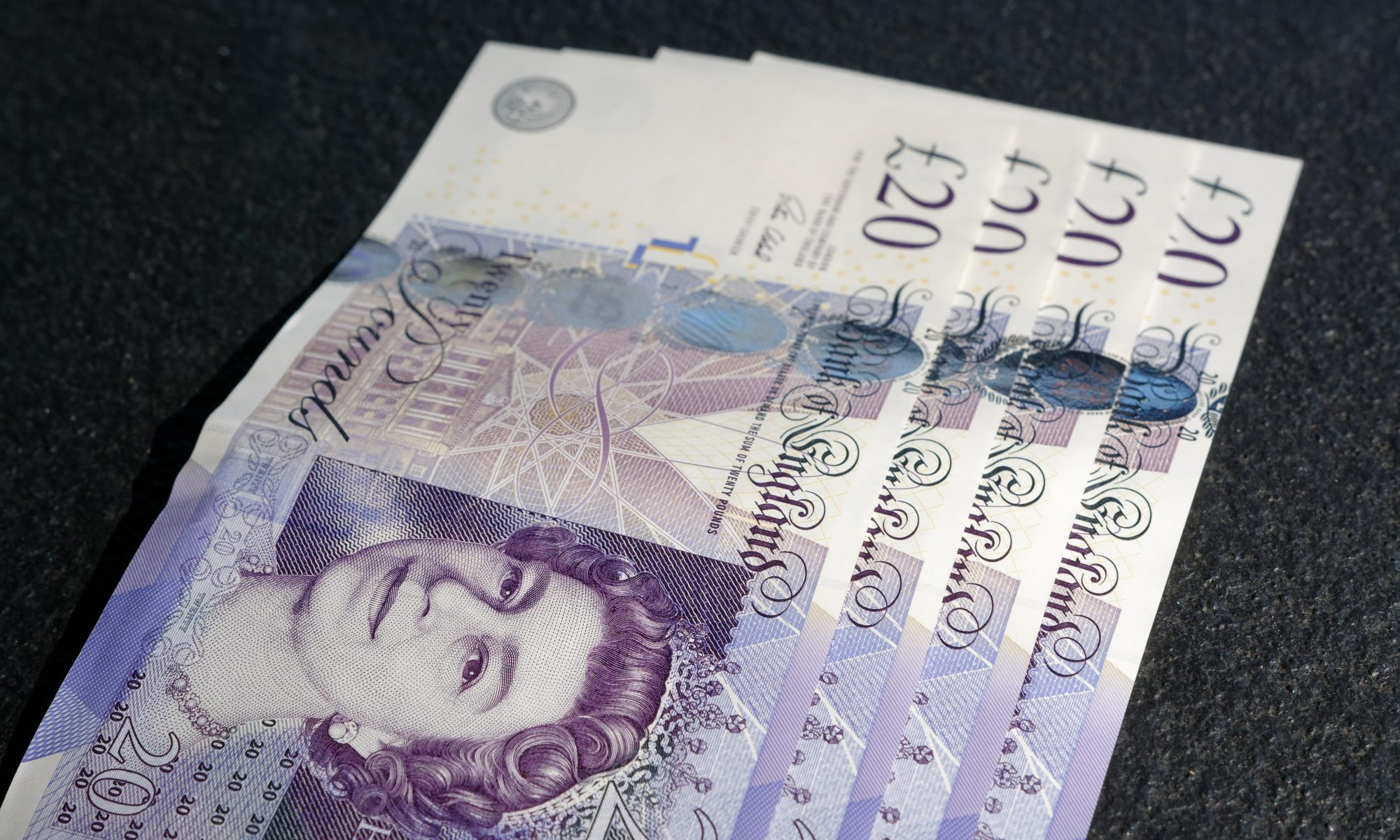 Four UK 20 Pound notes with the Queen's Head