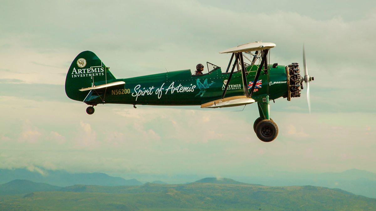 The Spirit of Artemis Biplane flies over Africa