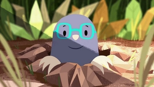 An animated mole peeks his happy face above ground