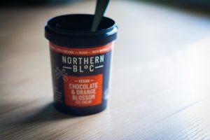 An empty tub of Northern Bloc Vegan Ice Cream